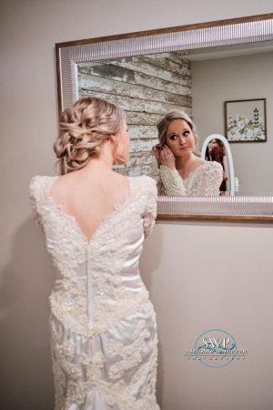 Bride in Mirror - Suzzie Wynveen Photography